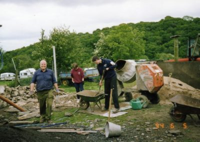 Volunteers build Welsh piggery shaped loo