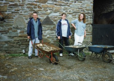 Wheel-barrowers gather stone for footings